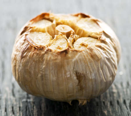 Close up of fresh roasted garlic bulb Фото со стока