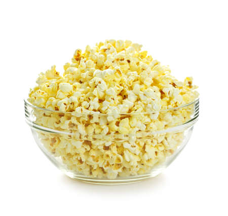 bowls of popcorn: Bowl of fresh popped popcorn isolated on white background Stock Photo