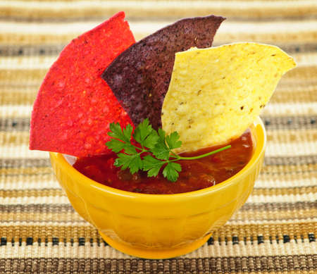 chips and salsa: Bowl of salsa with colorful tortilla chips