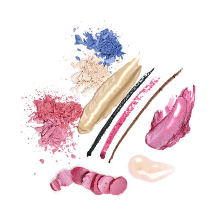 Abstract smeared cosmetics and makeup on white background photo