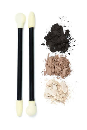 Eye shadow makeup applicators with crushed loose powder cosmetics photo
