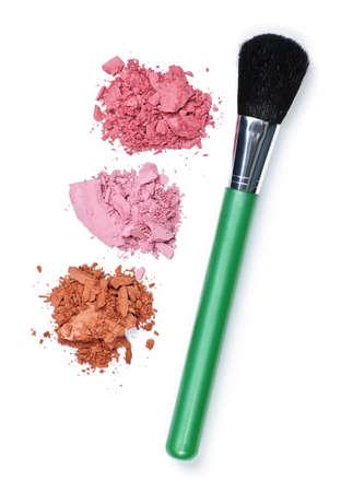 Blush cosmetics powder and makeup brush on white background