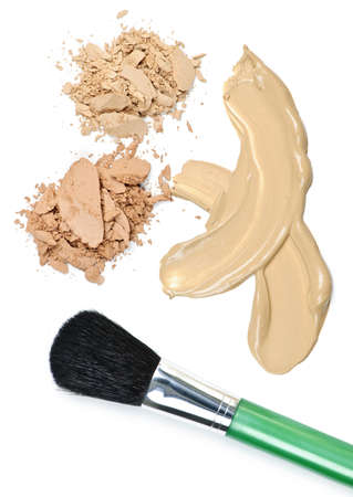 smeared: Cosmetic foundation cream and powder with brush on white background