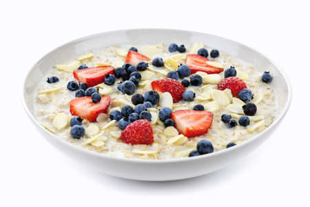 slivers: Bowl of hot oatmeal breakfast cereal with fresh berries Stock Photo