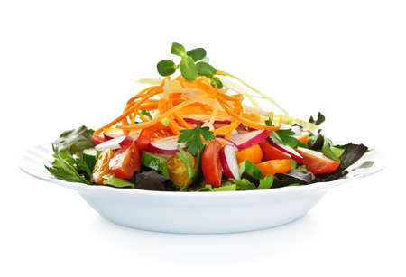 Plate of healthy green garden salad with fresh vegetables on white background