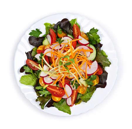 Plaat van gezonde groene tuin salade met verse groenten van boven  Stockfoto