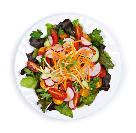 top: Plate of healthy green garden salad with fresh vegetables from above Stock Photo