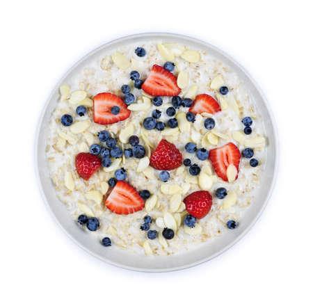 上からの新鮮な果実とホット オートミール朝食用シリアルのボウル 写真素材