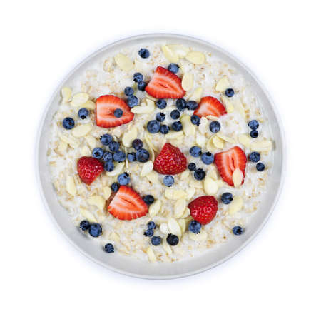 Bowl of hot oatmeal breakfast cereal with fresh berries from above photo
