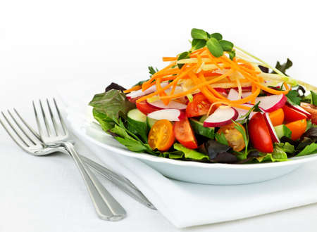 salad fork: Plate of healthy green garden salad with fresh vegetables