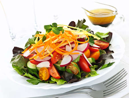 balsamic: Plate of healthy green garden salad with fresh vegetables served with balsamic dressing
