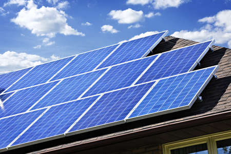 electric grid: Array of alternative energy photovoltaic solar panels on roof