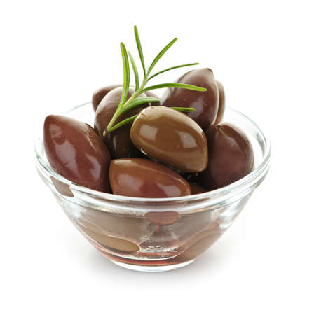 black olives: Kalamata olives in olive oil and herbs in bowl