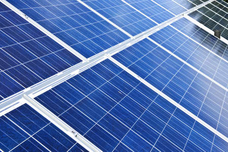 panel: Array of alternative energy photovoltaic solar panels Stock Photo