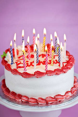Birthday cake with lit candles and white icing Stock Photo - 7983298
