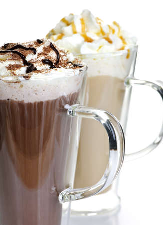 coffees: Hot chocolate and coffee latte beverages with whipped cream Stock Photo