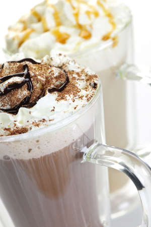 whipped: Hot chocolate and coffee latte beverages with whipped cream Stock Photo