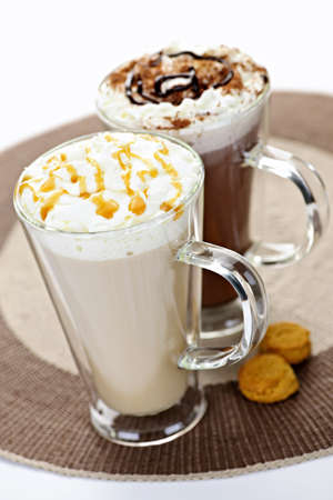 coffees: Hot beverages of coffee and chocolate with whipped cream Stock Photo