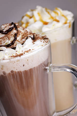 Hot chocolate and coffee latte beverages with whipped cream Imagens
