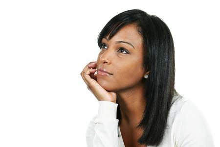 Thoughtful black woman looking up portrait isolated on white background Stock Photo - 7996147