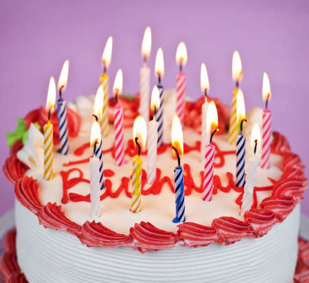 candle: Birthday cake with burning candles and icing