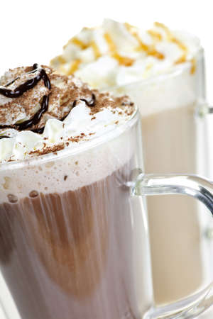 Hot chocolate and coffee latte beverages with whipped cream 版權商用圖片
