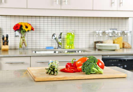 on kitchen: Modern kitchen interior with fresh vegetables on natural stone countertop Stock Photo