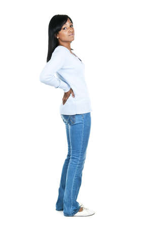 back ache: Black woman with back pain standing isolated on white background