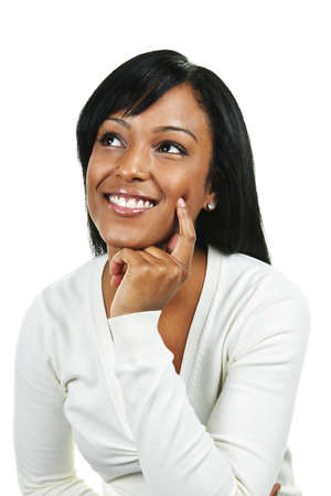 Smiling black woman looking up isolated on white background Stock Photo - 8163252