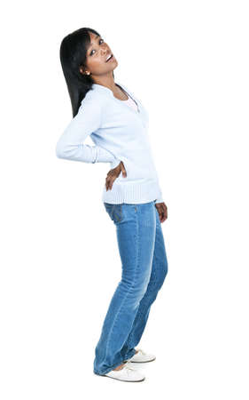 bending: Black woman with back pain standing isolated on white background