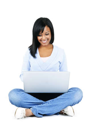 Happy black woman sitting with computer isolated on white background Stock Photo - 8163233