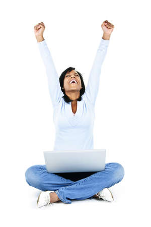 Excited black woman with arms raised and computer isolated on white background photo