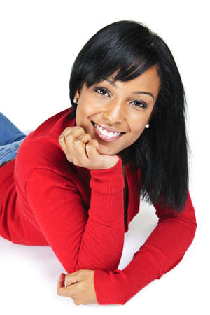 Portrait of black woman smiling laying isolated on white background Archivio Fotografico