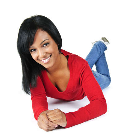 mixed race person: Portrait of black woman smiling laying isolated on white background Stock Photo