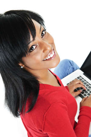 Smiling black woman looking up and typing on computer Stock Photo - 8264815