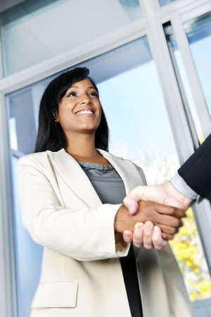 Portrait of black business woman shaking hands photo