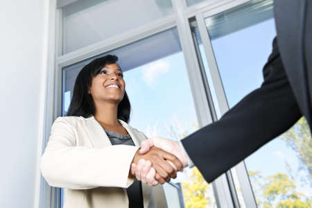 african business: Portrait of black business woman shaking hands