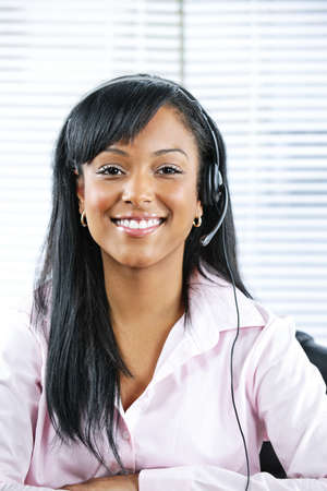 customer service representative: Smiling black customer service and support woman wearing headset Stock Photo