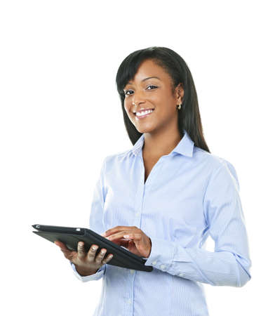 Young smiling black woman using tablet computer Stock Photo - 8436664