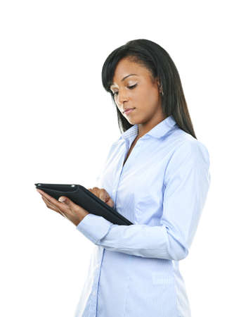 Young serious black woman working with tablet computer Stock Photo - 8436657