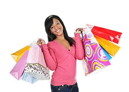 shopper: Young smiling black woman holding colorful shopping bags