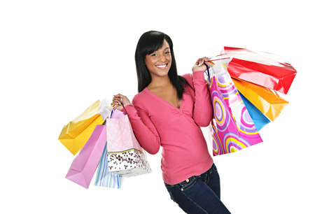 Young smiling black woman holding colorful shopping bags photo