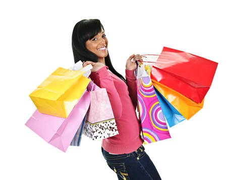 luxuries: Young smiling black woman holding colorful shopping bags