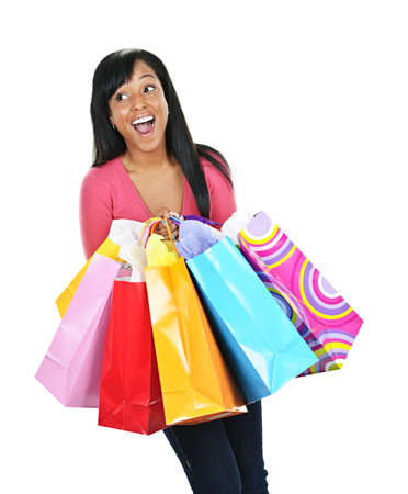 spree: Young happy excited black woman holding shopping bags Stock Photo