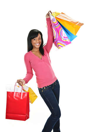 shopper: Young excited smiling black woman holding shopping bags