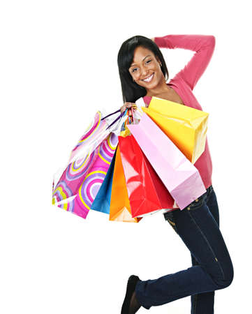 or spree: Young excited smiling black woman holding shopping bags
