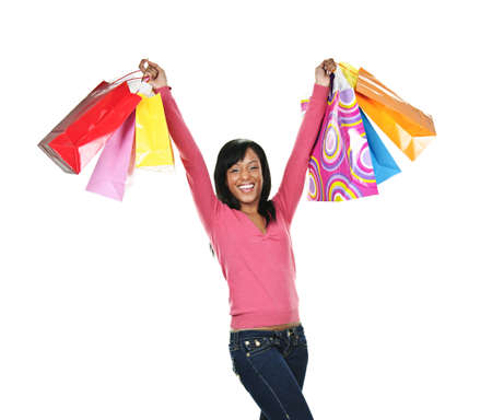Young excited smiling black woman holding shopping bags photo