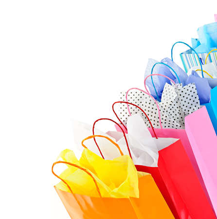 Many colorful shopping bags on white background photo