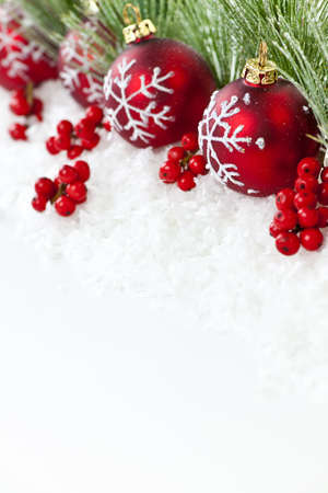 Red Christmas decorations with pine branches with copy space 스톡 콘텐츠
