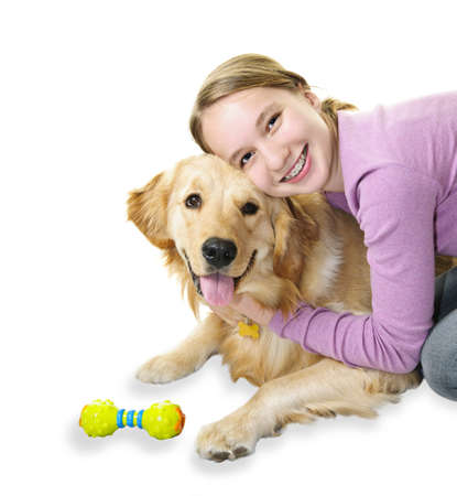 Teenage girl hugging golden retriever pet dog isolated on white background photo